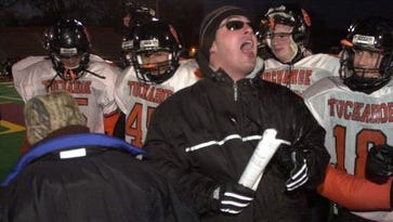 Tuckahoe Assistant Coach Patrick Gallo cheers with his players after beating Chester High School in the Class D regional football game at Dietz Stadium in Kingston on Nov. 13, 2004. The Tigers won 14-0.