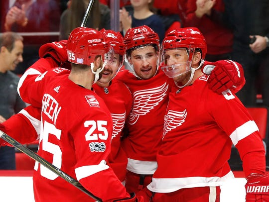 Red Wings center Dylan Larkin, third from left, celebrates