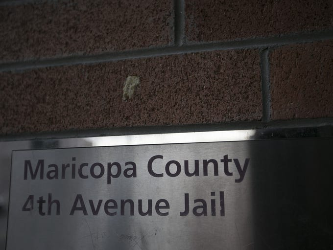 A sign on the wall of thethe 4th Avenue Jail sits in