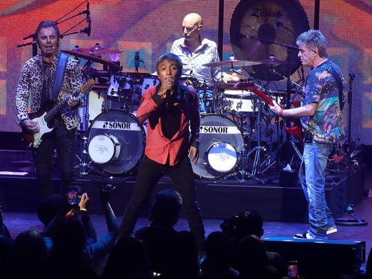 Journey performs at the American Family Insurance Amphitheater