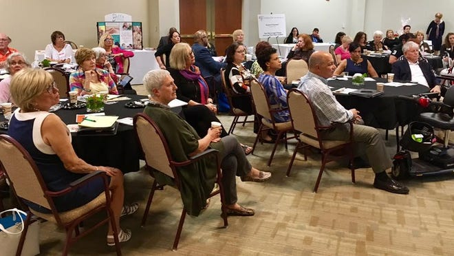 """Attendees listen as guest lecturer Chris Farrell discusses his book """"Unretirement: How Baby Boomers Are Changing the Way We Think About Work, Community and the Good Life"""" during an Encore PBC event. The nonprofit's speaker events discuss retirement issues, finding new meaning and purpose in aging, and dealing with discrimination in the workplace."""
