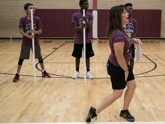 Adrienne McDowell leads a game during the CrossFit class on Friday. She pressured PE teacher Nicholas Ayers to bring CrossFit to Lehigh Acres Middle School.