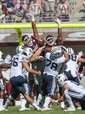 MSU defenders attempt to block a field goal in the first half. Mississippi State and BYU played in a college football game on Saturday, October 14, 2017 in Starkville. Photo by Keith Warren