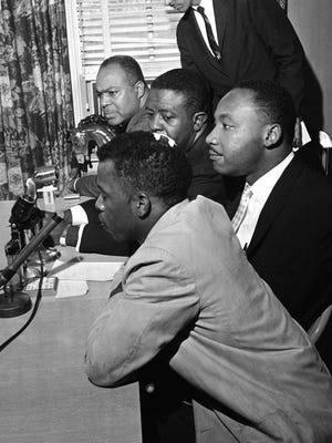 FILE - In this May 23, 1961 file photo, civil rights leaders, from front to back, John Lewis, Martin Luther King Jr., Rev. Ralph Abernathy and James Farmer, hold a news conference in Montgomery, Ala. to announce that the Freedom Rides will continue. Lewis, one of the riders that was beaten, wears a bandage on his head. A 1960 recording of an interview with King never before heard in public is up for sale. The tape was recorded by a Chattanooga man hoping to write a book and captures King talking about his trip to Africa, and his certainty that the child he and Coretta Scott King were expecting would be a boy.