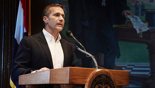 Missouri Gov. Eric Greitens reads from a prepared statement as he announces his resignation during a news conference, on May 29, 2018, at the state Capitol, in Jefferson City, Mo. Greitens resigned amid a widening investigation that arose from an affair with his former hairdresser. Greitens said his resignation would take effect on June 1, 2018.