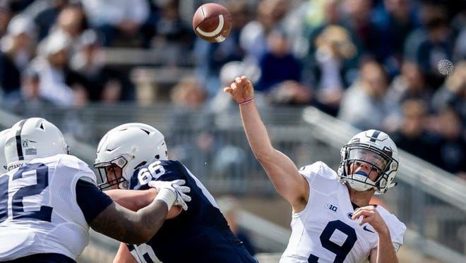 Penn State quarterback Trace McSorley, right, throws during the first quarter of the Blue-White spring college football game Saturday, April 21, 2018, in State College, Pa.