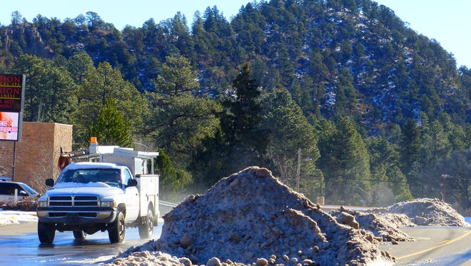 Snow is piled up on Sudderth Drive, evidence of the effort of Ruidoso Street Department crews that cleared main arteries as well as many side roads after the storm.