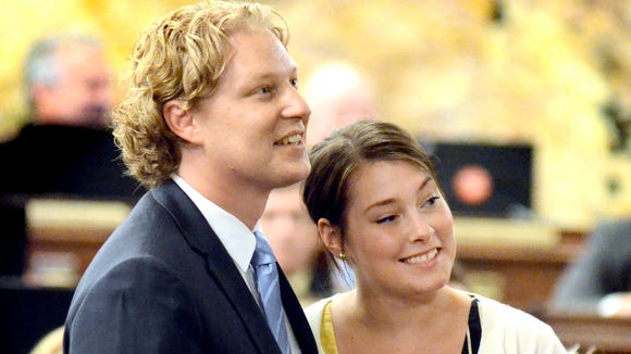 Kevin Schreiber stands with his wife, Jen, before taking
