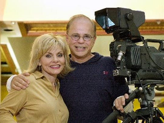 In this 2002 photo, Jim Bakker and his wife Lori stand