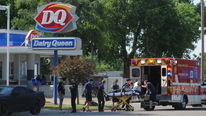 Salina emergency responders load a woman who was shot in the back into the ambulance near Dairy Queen, 321 N. Ninth St., at about 4:40 p.m. Sunday. A Topeka man, Michael Haffner, was taken into custody in connection with the shooting at the Airliner Motel, 781 N. Broadway Blvd.