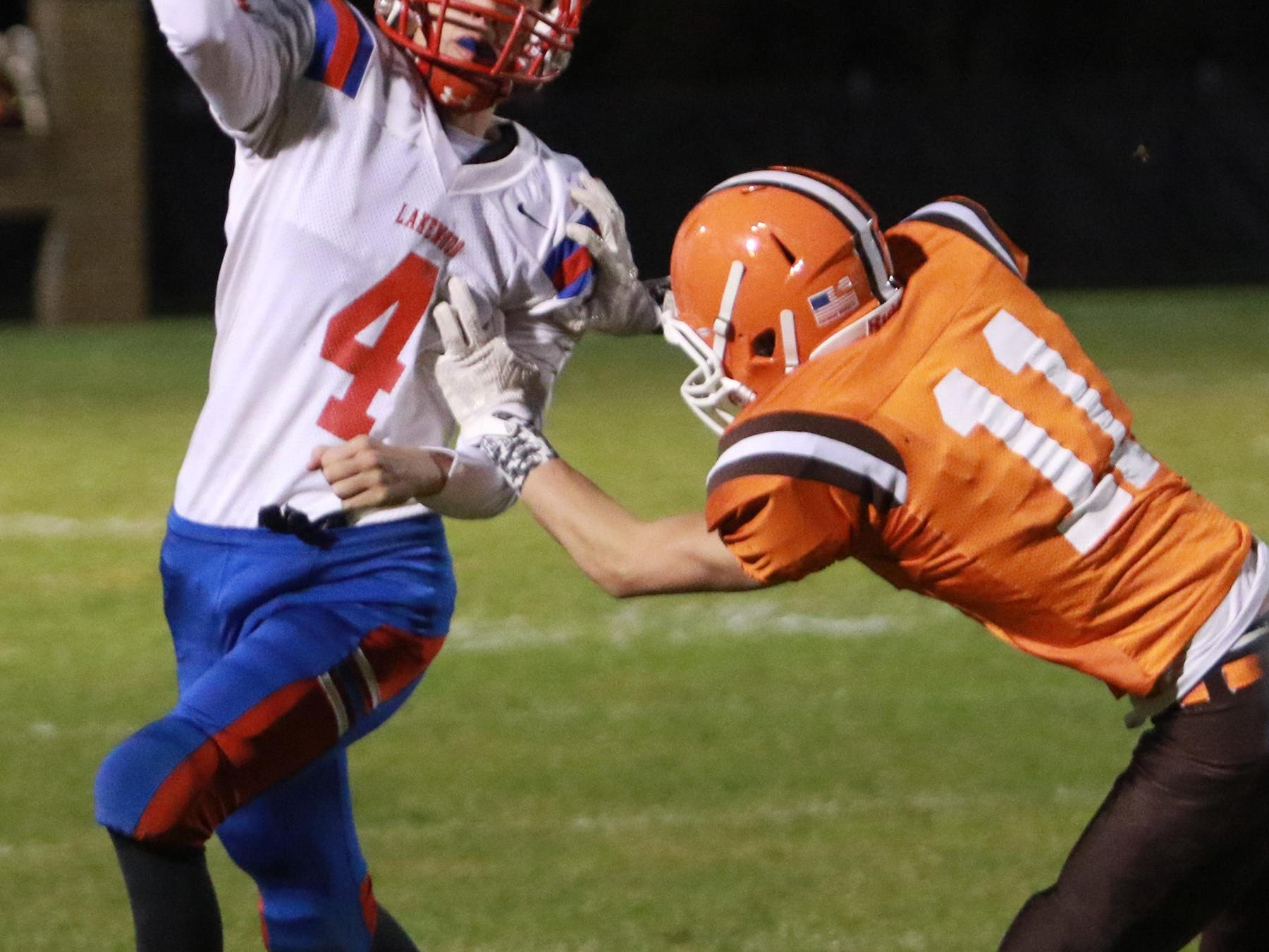 Heath senior Kordell Wiley applies pressure to Lakewood quarterback Cole Glaub during this past Friday's game.