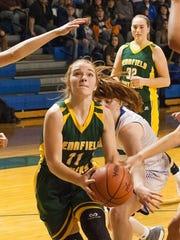 Pennfield's Melanie McIntyre drives to the basket against Harper Creek defenders. Both Pennfield and Harper Creek are still in the race in the Interstate 8 Conference.