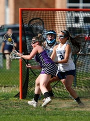 Rumson-Fair Haven's Liz Scarrrone controls the ball in front of Freehold Township's Maddie Hoskins (#8) during their game at Freehold Township High School Monday, May 1, 2017