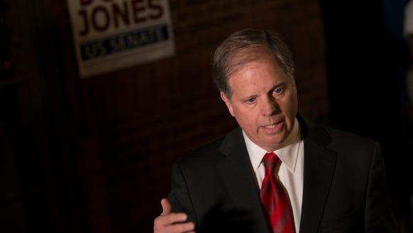 Democrat Senate nominee Doug Jones speaks to members