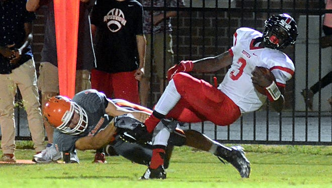 Rossview sophomore running back Isaiah Phillips spins out of a tackle by Beech junior defensive Alex Vanzant.