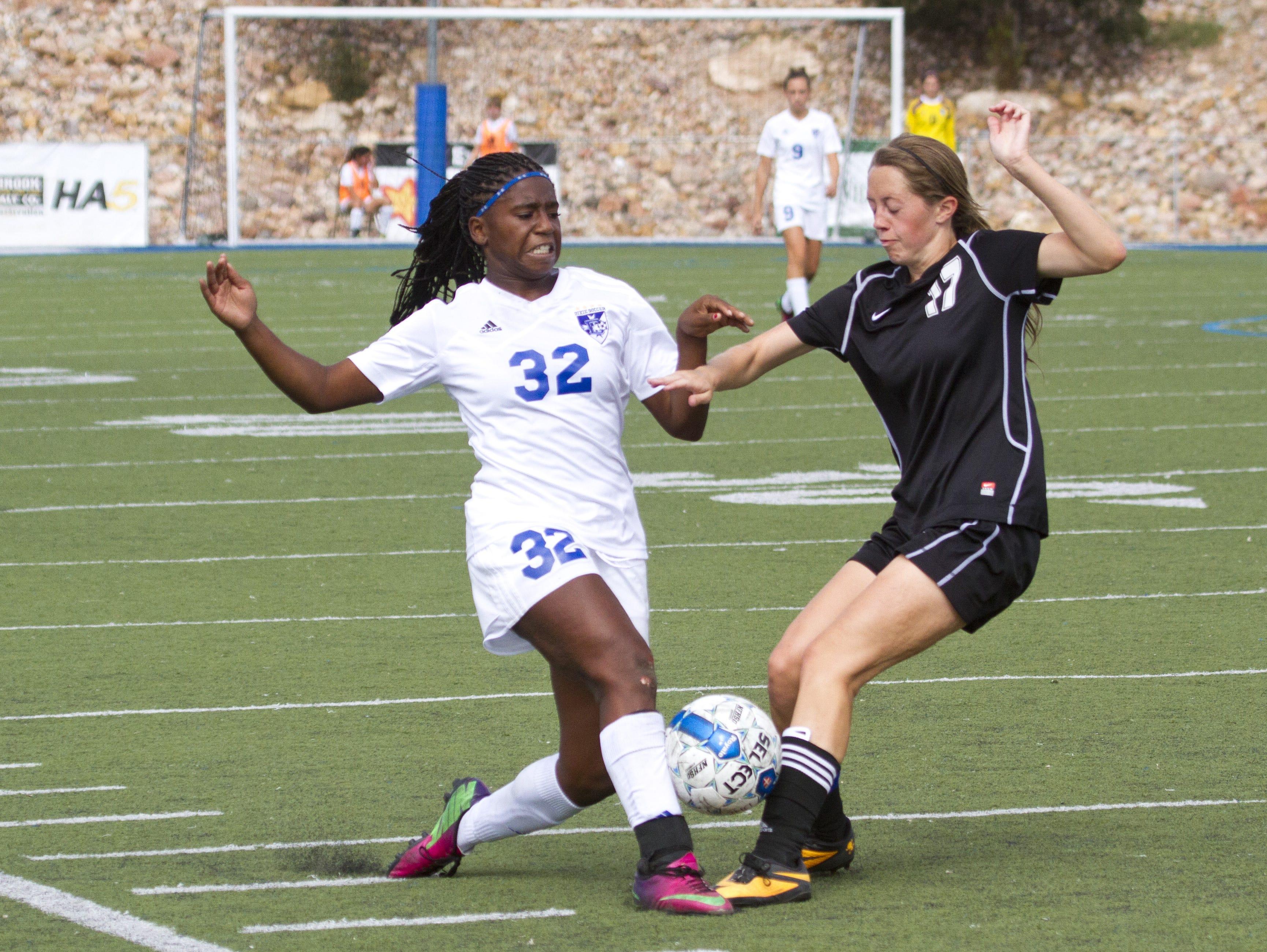 Dixie forward Starlee Woodbury shoots around Stansbury defender Erika Lakin Saturday, Oct. 18, 2014.