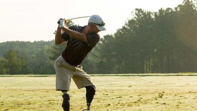 """""""Golf in general has been extremely therapeutic for me,"""" says retired Sgt. Andrew Smith, who lost both legs in Afghanistan."""