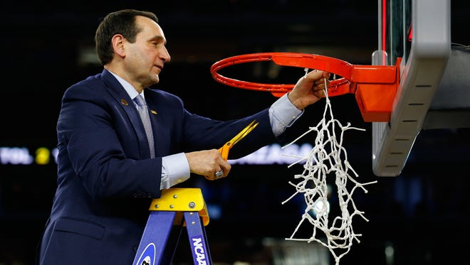 Duke coach Mike Krzyzewski cuts down the net after defeating the Gonzaga Bulldogs 66-52 in the South Regional Final of the 2015 NCAA Men's Basketball Tournament at NRG Stadium on March 29, 2015 in Houston, Texas.