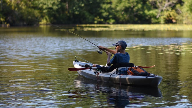 Evan Warwick,12, of Upper Deerfield goes fishing in a kayak at Parvin State Park in Pittsgrove on Labor Day.