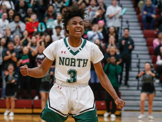 Des Moines North junior Tyreke Locure reacts after nailing a three-point shot against Johnston on Tuesday, Feb. 27, 2018, at Ankeny High School in Ankeny.