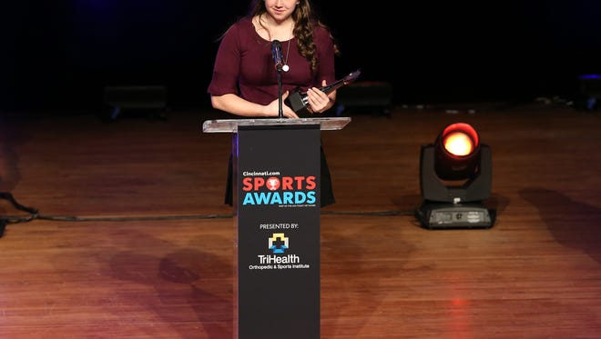 Jenna Dumont, of Ville Madonna High School, accepts the I Am Sport award, which recognizes the student-athlete committed to getting kids active during the 2018 Cincinnati.com Sports Awards presented by TriHealth, Monday, April 23, 2018, at Music Hall in Cincinnati.