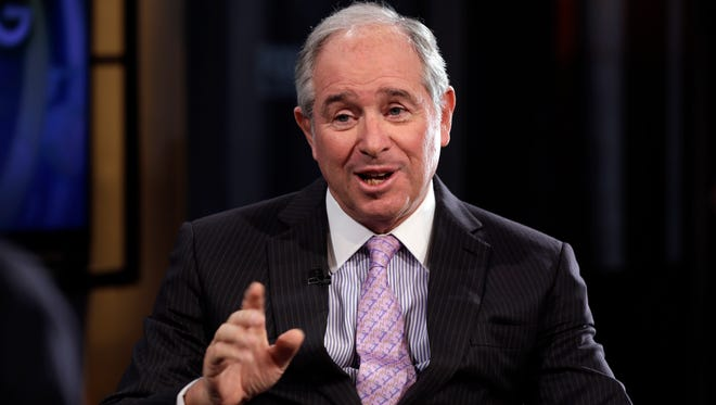 """File photo taken in 2014 shows Blackstone Group CEO Stephen Schwarzman being interviewed by Fox Business Network and USA TODAY columnist Maria Bartiromo during her Fox """"Opening Bell with Maria Bartiromo"""" program."""
