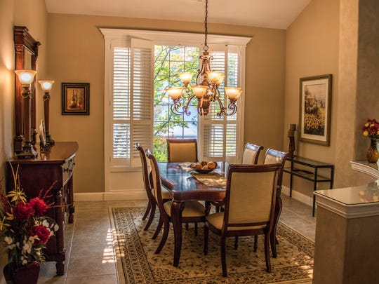 Soft colors invite guests to enjoy themselves in the Lollar home's dining room.
