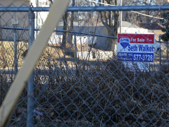 A for sale sign sits in the yard of a Capitol Park