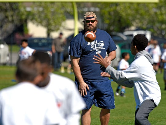 Former Chicago Bears Offensive Lineman Josh Sitton watches as young athletes participate in the Josh Sitton & Friends City of Champions Football ProCamp Saturday, March 3 2018 at Catholic High School.Throughout his one-day camp, Josh Sitton and other coaches offered tips and hands-on instruction, including lectures, fundamental football skills stations, contests, and non-contact games in a high-energy, fun, and positive environment. Campers were placed in small groups by age to ensure that each child got maximum instruction. Each attendee receiveda souvenir autograph from Josh Sitton a camp team photo with Josh Sitton and limited-edition Josh Sitton Football ProCamp t-shirt.