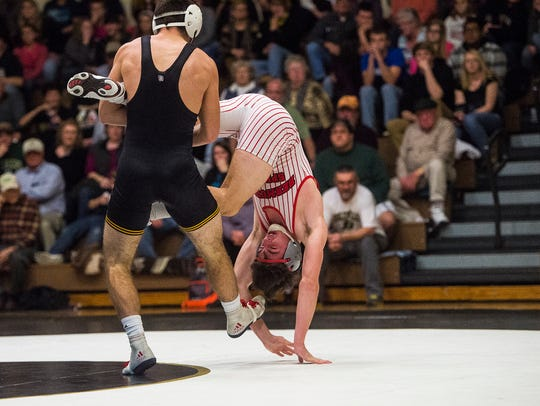 Bermudian Springs' Lucas Gladfelter is toppled upside