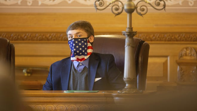 Rep.-elect Aaron Coleman, D-Kansas City, Kan., sits in a Democratic Party caucus Monday.