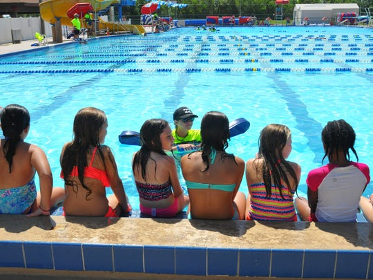 Courtney Pressler with her group of swimmers. Children at the Cocoa Beach Aquatic Center participated in the world's largest swim lesson Thursday morning. Thousands of kids and families at pools, aquatic centers and water parks around the world participated in the mass swim lesson to teach water safety and prevent drowning.