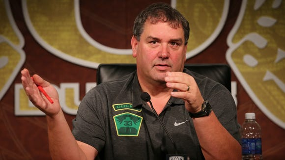 Brady Hoke talks to the media earlier this year after being hired as Oregon's defensive coordinator.