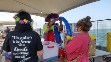 Magic the Clown entertained young people during Fiesta de la Flor with tricks and ballooon animals.