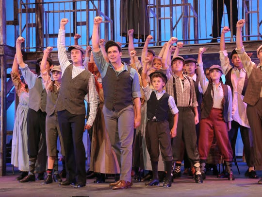 Cast members of Disney's Newsies perform during a rehearsal