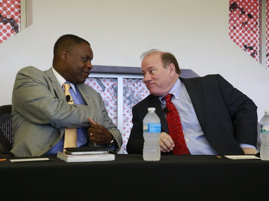 Detroit Emergency Manager Kevyn Orr and Mayor Mike Duggan  prepare for the long-awaited Blight Removal Task Force report reveal outlying the city's plans at Focus Hope in Detroit, Tuesday, May 27,  2014.