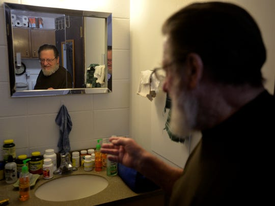 Air Force veteran Ralph Pottratz talks about the medications he takes daily in his Great Falls apartment. He says the VA helps him pay for his medications.