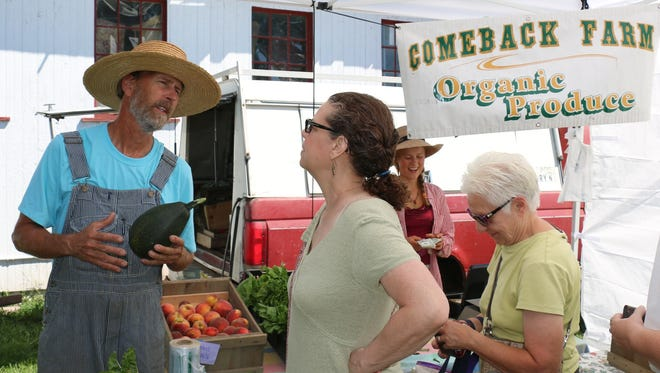 Comeback Farm's Mark Canright chatting with a customer.