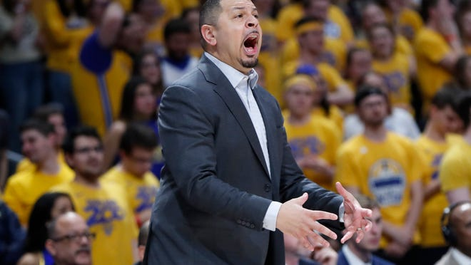 Pittsburgh head coach Jeff Capel instructs his team as they play against Syracuse during the first half of an NCAA college basketball game, Wednesday, Feb. 26, 2020, in Pittsburgh. Capel enters his third season at Pittsburgh hoping the Panthers can hang tough in the ACC. Promising starts in each of his first two years on the job ended with the Panthers in a tailspin. (AP Photo/Keith Srakocic)
