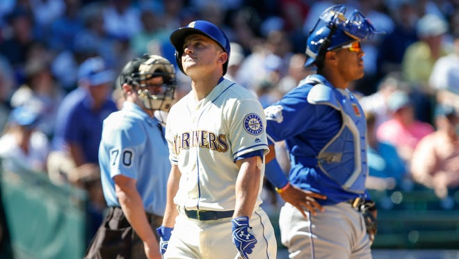 Mariners third baseman Kyle Seager (center) reacts to striking out with the bases loaded early last season against Kansas City.
