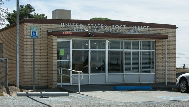 """The doors are locked at the Organ Post Office on Thursday, March 3, 2016, as the facility is temporary closed. A sign is posted on the door that reads, """"The Organ Post Office is temporarily closed due to building repairs until further notice. Mail is available for pick up at the Dona Ana Post Office."""