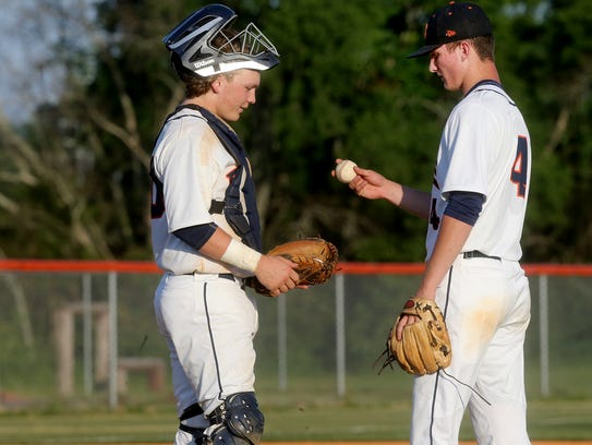 Blackman's catcher Peyton Milam (20) talks with pitcher