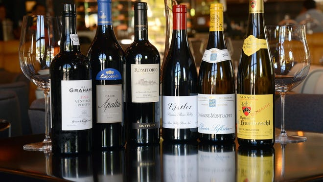 Meat Market and other restaurants in town are permitted to sell sealed bottles of wine with takeout and delivery food orders.
