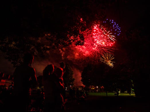 Spectators watch the fireworks display on Memorial