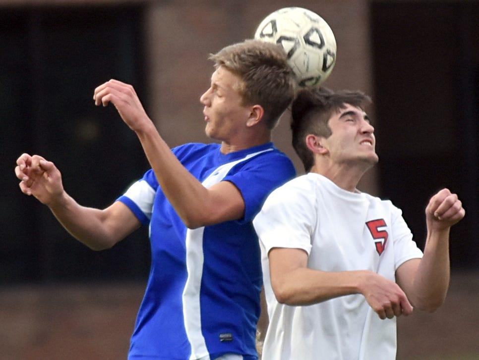 Westmoreland High senior midfielder Caden McCormick elevates for a first-half header along with Jackson County junior Cory Jordan.
