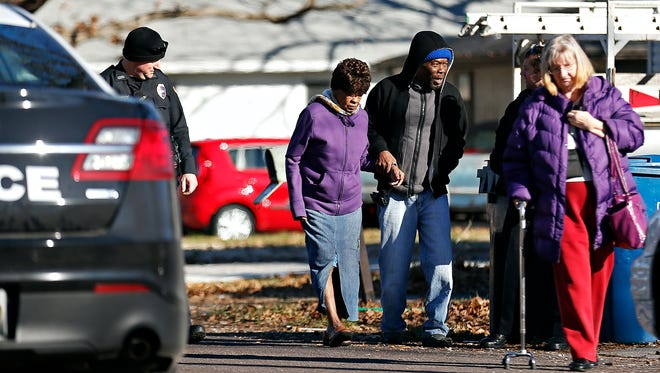 Alejandrina Patroni is escorted back to her car after being thought missing by Springfield Police. Police officers searched for her in the area around her Springfield house on Dec. 17, 2015.