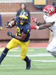 Michigan's Donovan Peoples-Jones runs by  Rutgers'