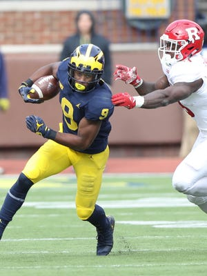 Michigan's Donovan Peoples-Jones runs by  Rutgers' Gus Edwards in the fourth quarter Saturday, Oct. 28, 2017 at Michigan Stadium.