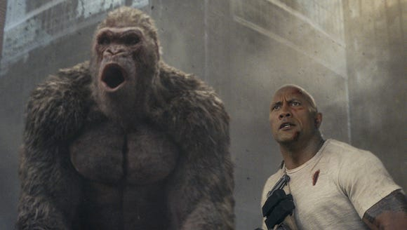 "Dwayne Johnson makes friends with a gorilla in ""Rampage."""