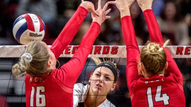 Illini Bluffs' Hanna Hicks, middle, spikes the ball during the Class 1A volleyball state semifinals Friday, at Redbird Arena in Normal. Hicks and her team were both honored during the Best of Preps awards.